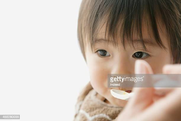 Baby eats baby food