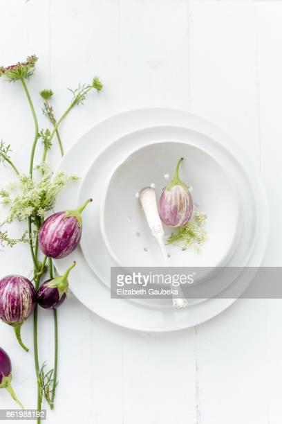 Baby Eggplant on a white porcelain colander