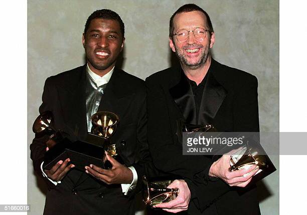 Baby Face and Eric Clapton hold their Grammy Awards 26 February in New York The two won the record of the year for 'Change the World' AFP PHOTO Jon...