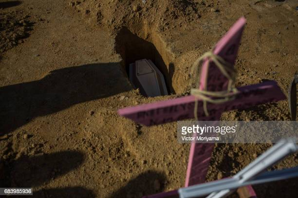 Baby Fernanda Rattia who died of pneumonia at 10 months is buried May 15 2017 in Manaus Brazil Parents Petra Cardona and Simon Rattia who...