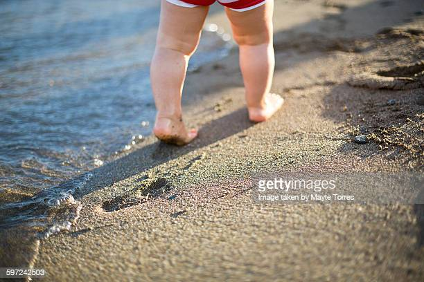 Baby footprints at the beach