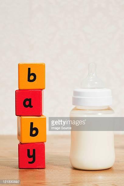 Baby formula and alphabet blocks