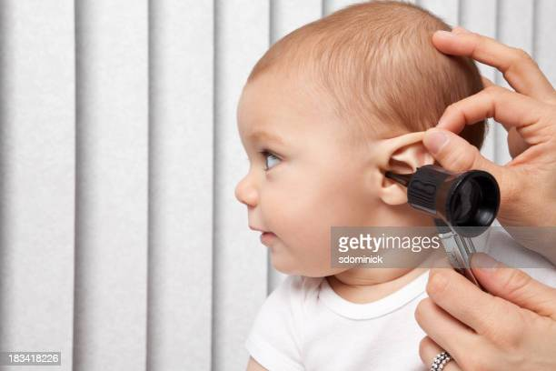 Baby Getting Ear Checked With Otoscope