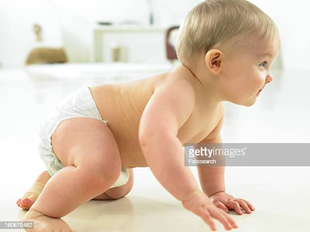 Baby getting up off floor to stand