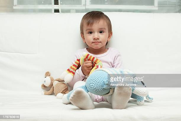 Baby girl and her crocheted friends