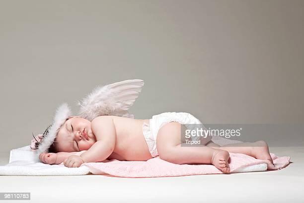 Baby girl angel sleeping on blanket