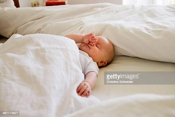 Baby girl asleep on bed