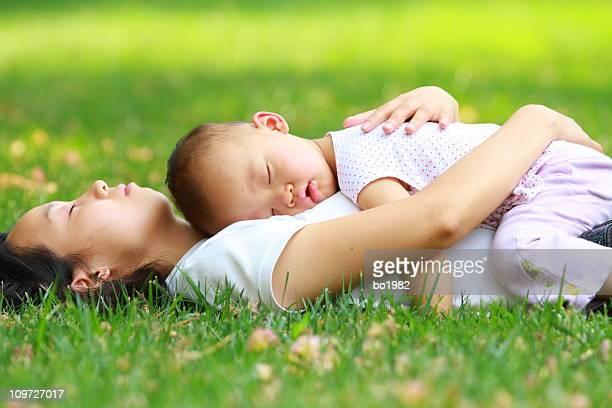 baby girl asleep on her mom's chest