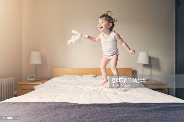 Baby Girl Bouncing on Bed
