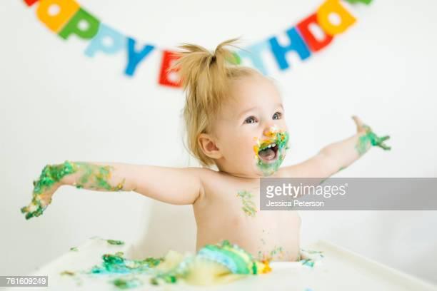 Baby girl (12-17 months) celebrating first birthday