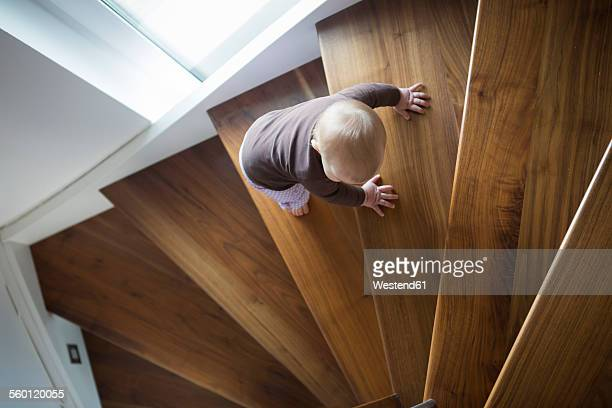 Baby girl climbing up a stair