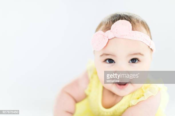 baby girl crawling, development stage - one baby girl only stock pictures, royalty-free photos & images