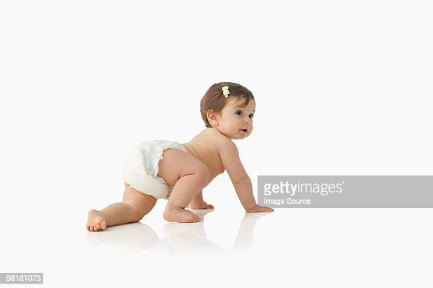 baby girl crawling - windel stock-fotos und bilder