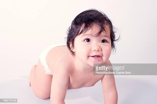 Baby girl crawling, portrait