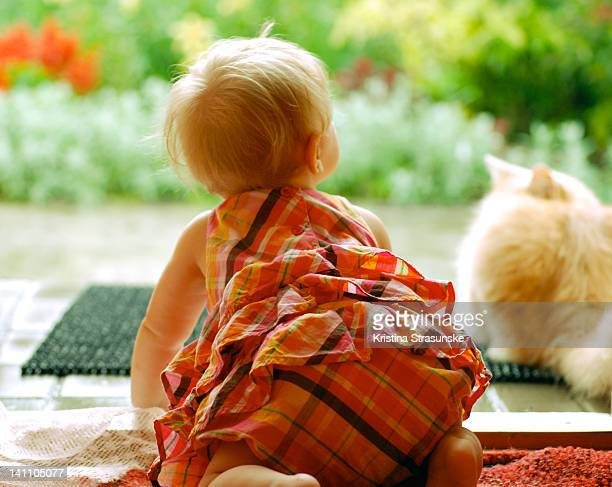 Baby girl crawling with cat