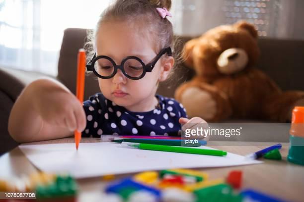 close up baby girl drawing at