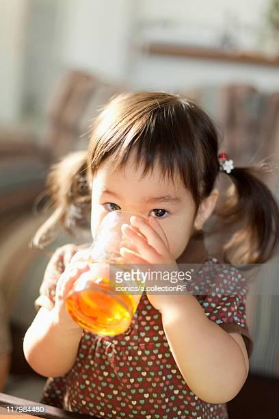 Baby Girl Drinking Juice