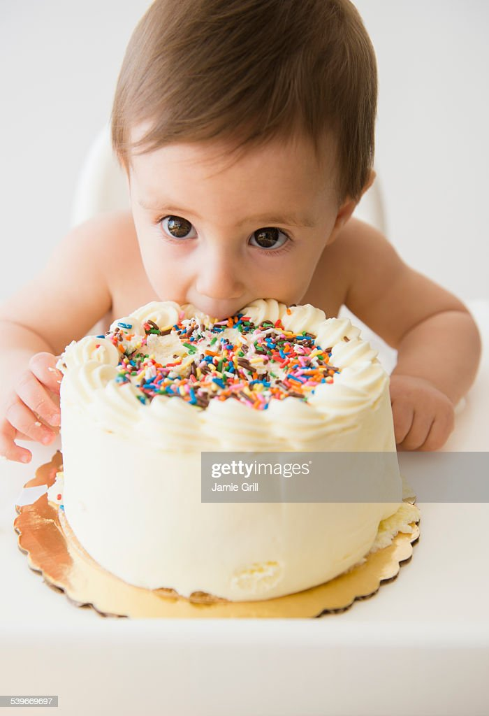 Baby Girl Eating Birthday Cake Stock Photo - Getty Images-2696