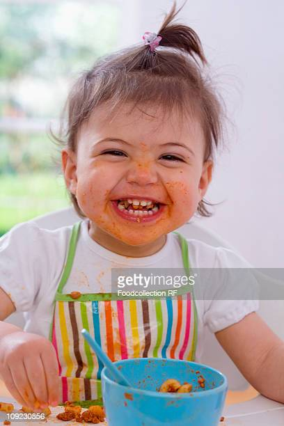 Baby girl (18-23 Months) eating pasta with bolognese sauce, close-up