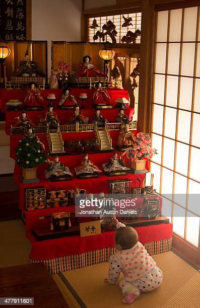 baby girl enjoying japanese hina-matsuri dolls - hinamatsuri stock pictures, royalty-free photos & images