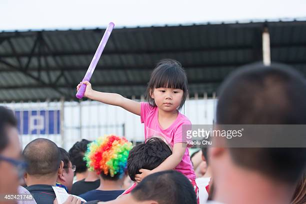 A baby girl enter the arena with her father in 2014 Zhangbei Grassland Music Festival on July 19 2014 in Beijing China Zhangbei Grassland Music...