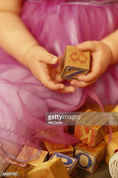 Baby Girl Holding Toy Block