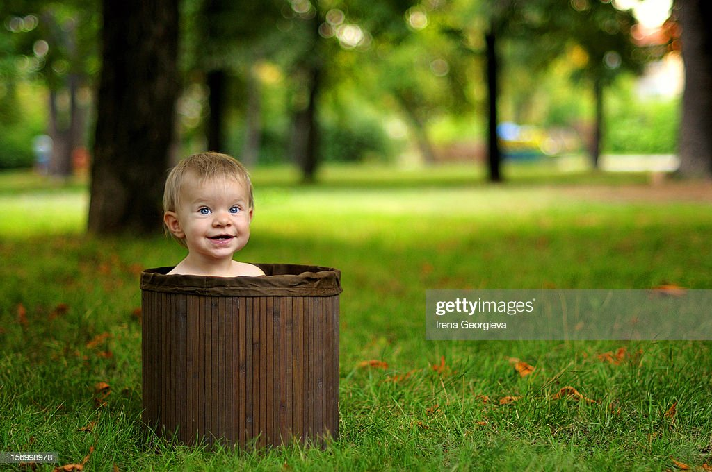 Baby girl in a basket : Stock Photo