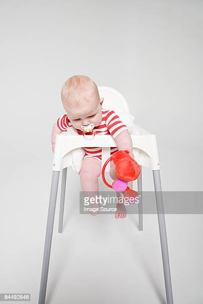 a baby girl in a high chair - one baby girl only stock pictures, royalty-free photos & images
