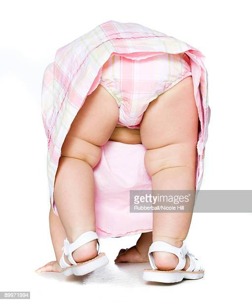 baby girl in a pink dress - bent over babes stock pictures, royalty-free photos & images
