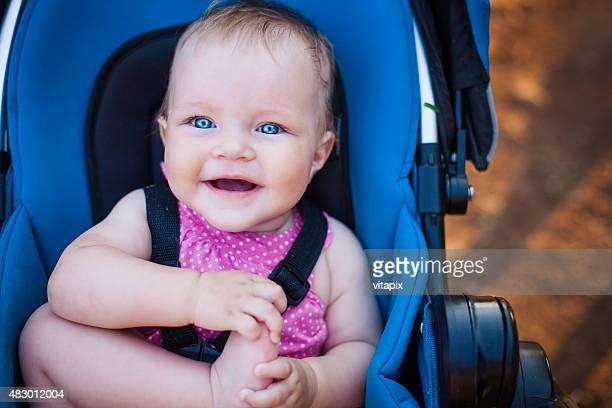 Baby girl in a stroller