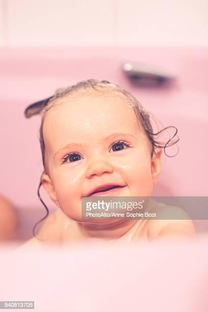 Baby girl in bath, portrait