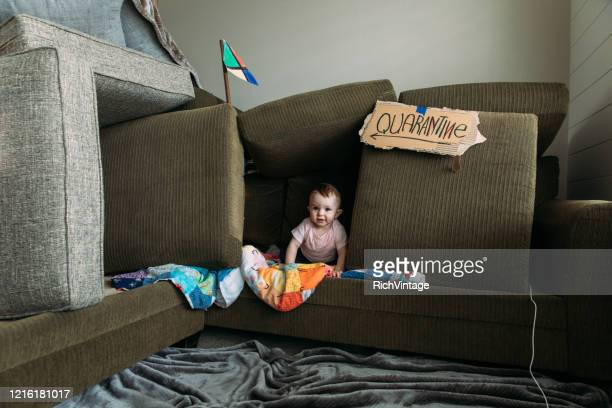 baby girl in couch fort - fort stock pictures, royalty-free photos & images
