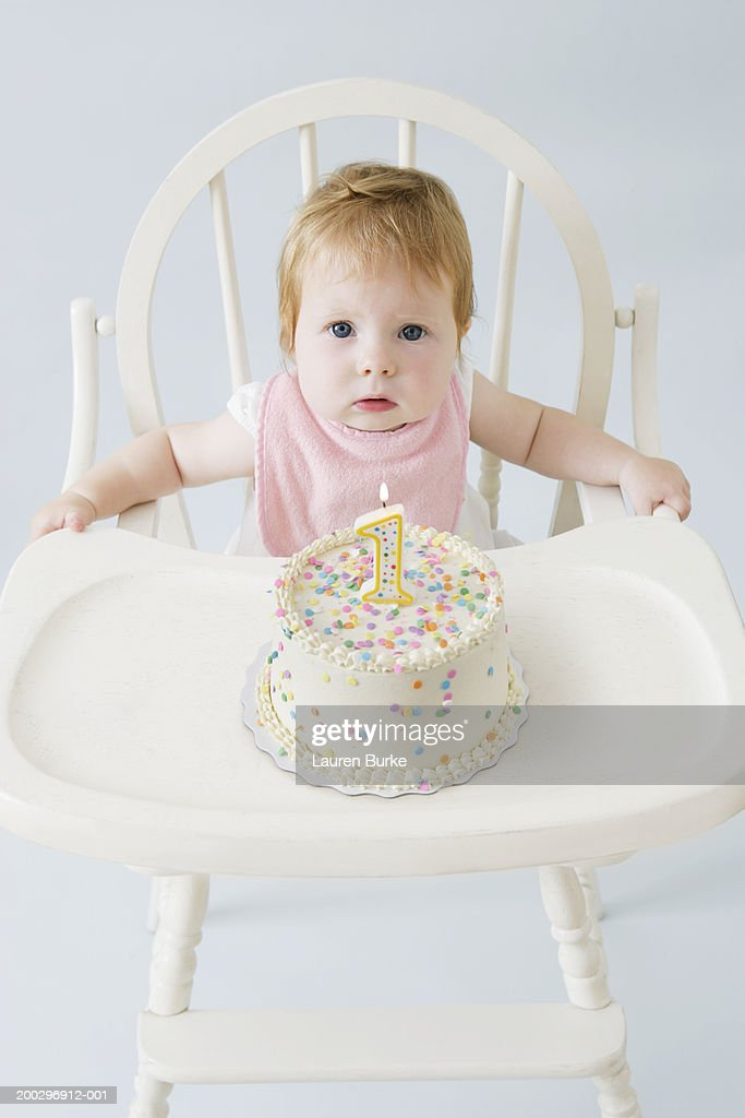 Astonishing Baby Girl In High Chair With Birthday Cake Portrait High Res Stock Funny Birthday Cards Online Necthendildamsfinfo