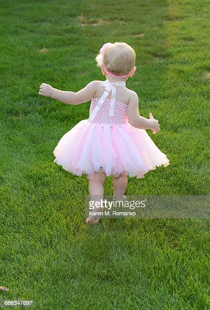 Baby girl in pink tutu running