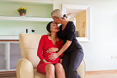mature woman is touching stomach her