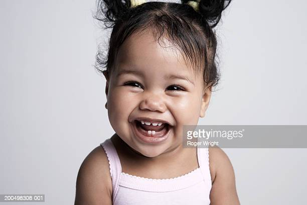baby girl (6-9 months) laughing, portrait - baby girls stock pictures, royalty-free photos & images