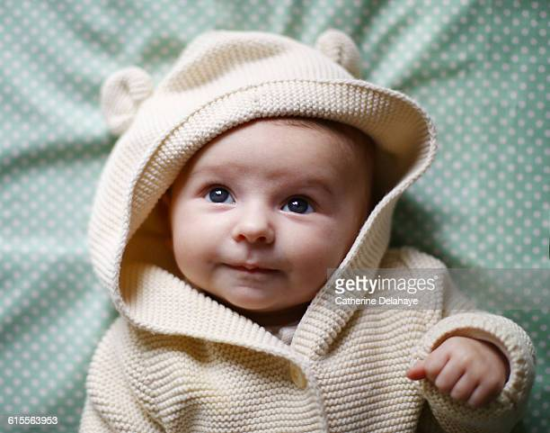 a baby girl laying on a bed - cute stock pictures, royalty-free photos & images