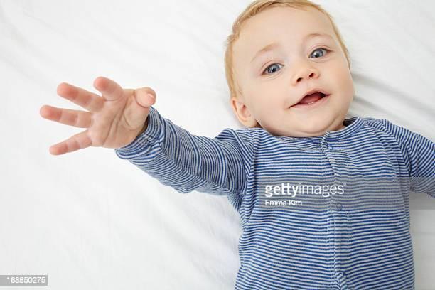 Baby girl laying on crib