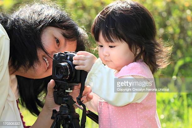 Baby girl learning photography