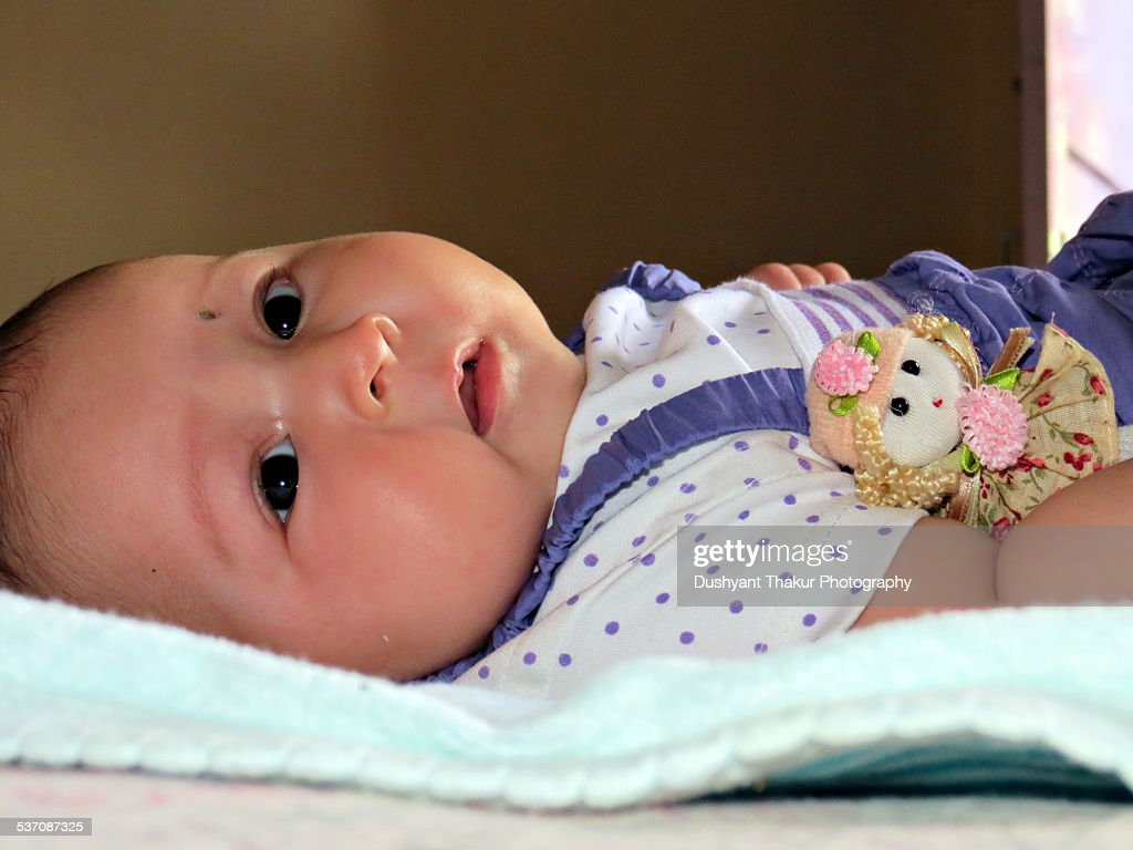 Baby girl looking at camera while lying down