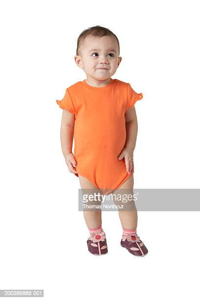 baby girl (12-15 months) looking up, smiling - baby onesie stock photos and pictures