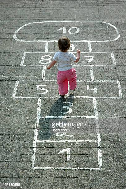 baby girl on childsplay - hopscotch - hopscotch stock pictures, royalty-free photos & images