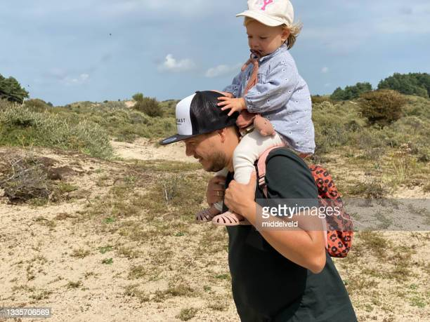 baby girl on shoulder - north holland stock pictures, royalty-free photos & images