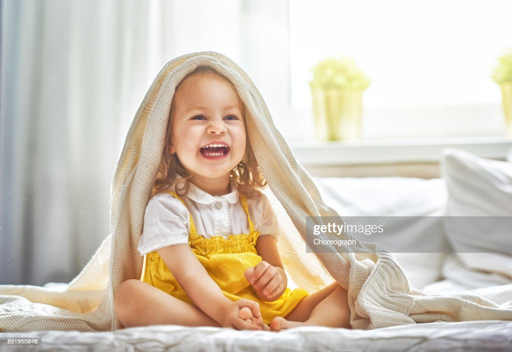 baby girl on the bed : Stock Photo