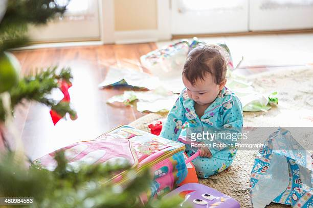 Baby girl opening christmas presents