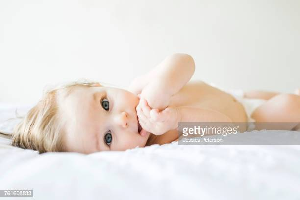 Baby girl (6-11 months) playing in bedroom
