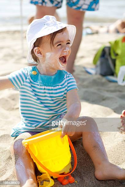 baby girl playing in the sand