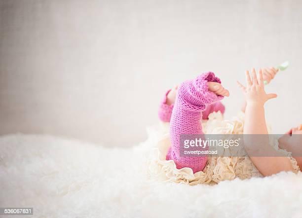baby girl playing - レッグウォーマー ストックフォトと画像