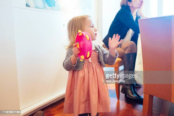 baby girl playing tambourine - tambourine stock pictures, royalty-free photos & images