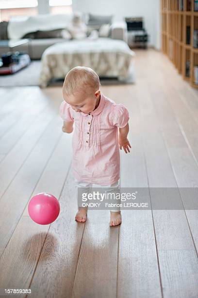 Baby girl playing with a ball